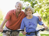 Photo of a man and woman on bicycles. Link to Life Stage Gift Planner Ages 60-70 Gifts.
