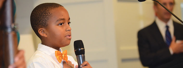 Photo of a boy with a microphone